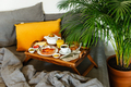 Turkish breakfast in bed with fried eggs, simit and coffee on table tray - PhotoDune Item for Sale