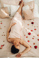 Calm beautiful lady relaxing on a flowery bed - PhotoDune Item for Sale