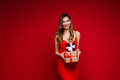 Sexy laughing woman in red with two presents - PhotoDune Item for Sale