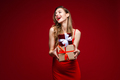 Gorgeous woman with presents on red background - PhotoDune Item for Sale