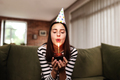 Birthday girl blows out a burning candle on a cupcake - PhotoDune Item for Sale