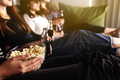 Group of people are watching a movie. Friend girls eat popcorn and drink soda - PhotoDune Item for Sale