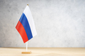 Russia table flag on white textured wall - PhotoDune Item for Sale