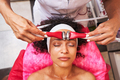 Competent beauty master massaging forehead with device - PhotoDune Item for Sale