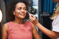 Positive delighted curly haired woman doing makeup - PhotoDune Item for Sale