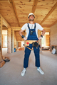 Housebuilder posing to camera with proud expression - PhotoDune Item for Sale