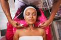 Delighted curly haired woman doing face lifting - PhotoDune Item for Sale