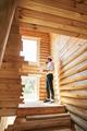 Housebuilder speaking through smartphone on staircase flight - PhotoDune Item for Sale
