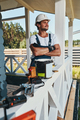 Construction worker folding hands on house porch - PhotoDune Item for Sale