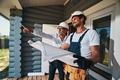 Housebuilder demonstrating something outside to pleased worker - PhotoDune Item for Sale