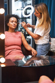 Professional stylist doing makeup for her client - PhotoDune Item for Sale