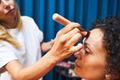 Focused photo on stylist putting base on face - PhotoDune Item for Sale