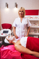 Positive delighted cosmetologist working in beauty studio - PhotoDune Item for Sale