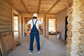 Builder is looking around house under construction - PhotoDune Item for Sale