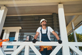 Civil engineer checking ceiling of house porch - PhotoDune Item for Sale