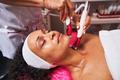 Cheerful female person enjoying professional face massage - PhotoDune Item for Sale