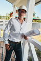 Fit construction engineer on porch posing for photo with blueprints - PhotoDune Item for Sale