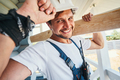 Light-hearted worker touching tip of his helmet - PhotoDune Item for Sale