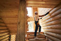 Construction worker is measuring log wall length - PhotoDune Item for Sale