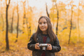 A little girl take a photo with old retro camera in autumn nature. Leisure and hobby concept - PhotoDune Item for Sale