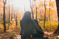 Mother with her daughter sitting on a stump in autumn park. Single parent and season concept - PhotoDune Item for Sale