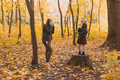 Mother photographer takes pictures of a her daughter in the park in autumn. Hobbies, photo art and - PhotoDune Item for Sale