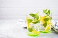 Lemonade in two glasses at white table - PhotoDune Item for Sale