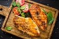 Grilled chicken fillet at wooden cutting board with vegetables - PhotoDune Item for Sale