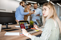 Portrait of a young woman with coworkers in the office - PhotoDune Item for Sale