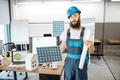 Worker in the alternative energy design office - PhotoDune Item for Sale
