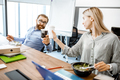 Man and woman eating salad on the work in the office - PhotoDune Item for Sale