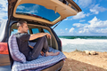 Young man relaxing by the ocean on a trip - PhotoDune Item for Sale