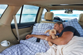 Sleeping young man on the ocean on a road trip - PhotoDune Item for Sale