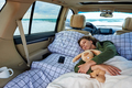 Sleeping young woman on the ocean on a road trip - PhotoDune Item for Sale