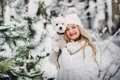 Portrait of a woman in a white sweater with a dog in a cold winter forest. A girl holds a dog in a - PhotoDune Item for Sale