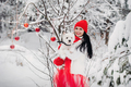 Portrait of a woman in a red jacket with a dog in a cold winter forest. A girl holds a dog in her - PhotoDune Item for Sale