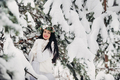 Portrait of a woman in white clothes in a cold winter forest. Girl with a wreath on her head in a - PhotoDune Item for Sale