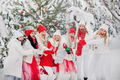 A large group of girls with glasses of champagne in their hands stands in the winter forest.Girls in - PhotoDune Item for Sale
