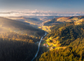 Aerial view of beautiful road in mountains at sunrise in autumn - PhotoDune Item for Sale