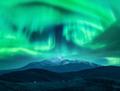 Aurora borealis over the snow covered mountain peak in europe - PhotoDune Item for Sale