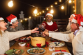 Happy multiracial senior friends toasting with red wine glasses during Christmas holidays dinner - PhotoDune Item for Sale