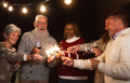 Happy seniors having fun celebrating holidays drinking wine and holding sparklers fireworks - PhotoDune Item for Sale