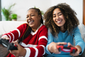 Happy African mother and daughter having fun playing online video games at home - PhotoDune Item for Sale