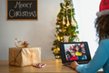 Happy African family having video call during Christmas time - PhotoDune Item for Sale