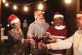 Happy senior friends celebrating Christmas holidays while toasting with red wine glasses - PhotoDune Item for Sale
