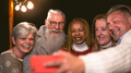 Happy multiracial senior friends having fun in holidays taking selfie with mobile smartphone - PhotoDune Item for Sale