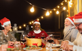 Happy senior friends dining together during Christmas holidays celebration on house patio party - PhotoDune Item for Sale