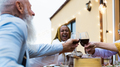 Happy multiracial seniors toasting with red wine glasses together on house patio dinner - PhotoDune Item for Sale