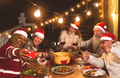 Happy senior friends dining and celebrating Christmas holidays taking selfie with mobile smartphone - PhotoDune Item for Sale