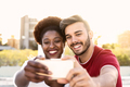 Happy couple taking selfie with mobile smartphone outdoor - PhotoDune Item for Sale